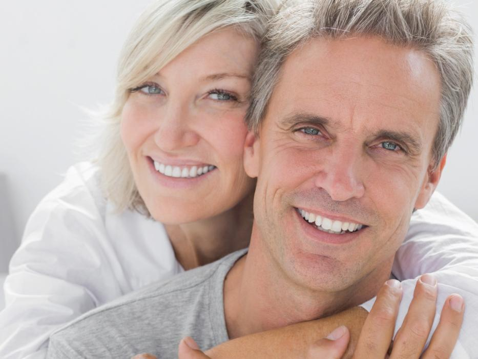 couple smiling with dental implants in nederland tx