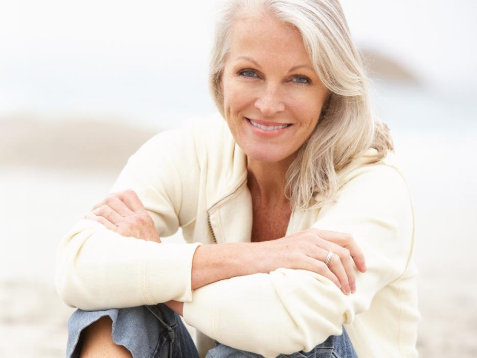 woman smiling with dental implants in nederland tx