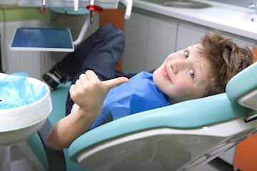 kid smiling during dental exam in nederland tx
