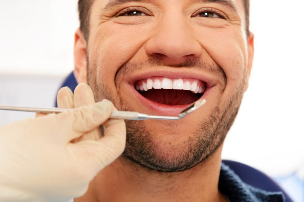 Happy Male General Dentist Patient | Nederland Family Dental: Dr. G. Whitney Gomez, DDS