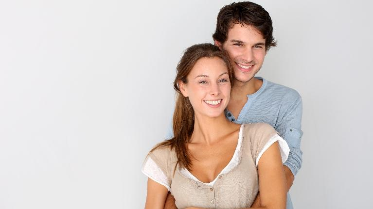 couple holding each other | dental implants nederland tx